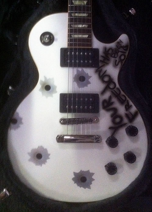 Custom painted bullet hole motif on a Les Paul